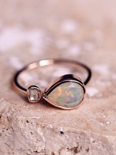 Opal x Rose Cut Diamond Ring | Handmade in France this gorgeous and delicate 9k rose gold ring features a teardrop shaped opal stone with a side rose cut diamond.