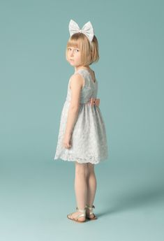 One of this summers top kidswear trends is lace, here in a pretty dress by Hucklebones for spring 2015