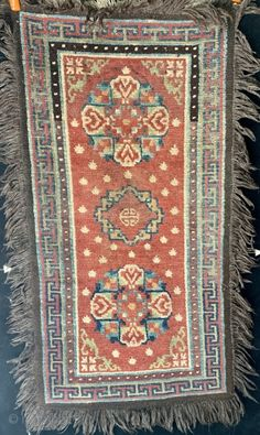 "Antique Tibetan khaden, 19th century, all dyes natural including beautiful rose and apricot. Three medallion pattern with double dorjee medallions flanking the central Chinese inspired figure. 53"" by 28"" not ... 