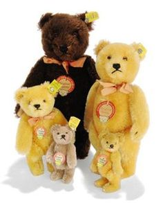 FIVE STEIFF POST-WAR JOINTED MOHAIR ORIGINAL TEDDIES, one brown, (5325,2), and one golden, (5322), both with brown and black glass eyes, black stitching, ribbons, script buttons, yellow cloth tags and chest tags --9½in. (24cm.) and 8¼in. (21cm.) high; a smaller similar golden, (5315,01), brown and black plastic eyes, script button, yellow cloth tag and chest tag; and two miniature bears, one golden and one caramel, one script button, one yellow cloth tag, two chest tags 	 (5)