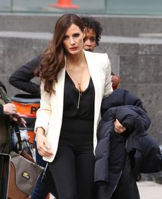 She was spotted on set wearing a plunging top under a smart white jacket