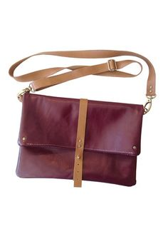 foldover crossbody - wine  Available at Taisteal Jewelry Abbot Kinney #popupshop #smallbusinesssaturday #holidayshopping