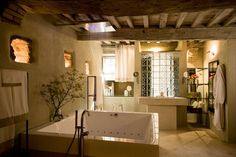 Like the soft light that comes into this bathroom, not stepping into shower everday though, rather open floor.   A retreat in the UNESCO World Heritage Site of the Val d'Orcia, Tuscany. Interior design: Ilaria Miani www.ilariamiani.it, property by www. monteverdituscany.com