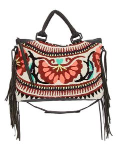 - Thick textured cotton body - Leather wrapped double handles and hardware with 6.5in drop - Side fringe detailing - Adjustable shoulder strap - Fringed detail - Exterior zip pocket - Measurements: 18