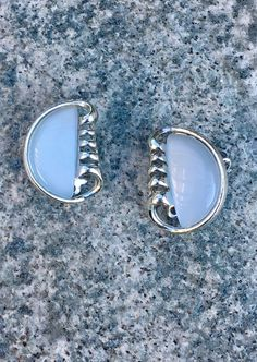 Fun Vintage Clip-on Earrings Signed Coro.  https://www.etsy.com/listing/540068967/pale-blue-vintage-coro-clip-on-silver