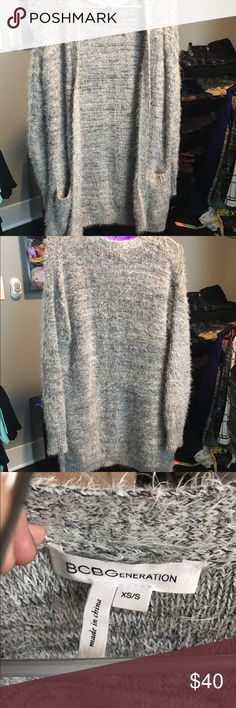 BCBG Stretch Fuzzy Cardigan SO SOFT. Stretchy. Like one of the super soft throw blankets almost. Heather grey with front pockets. Worn a couple times. Cute fuzzy style without being poofy or making you look bulky.  I consider all reasonable offers, but no trades - thanks!!! 💕✨👀 its XS/S but I wear ML and it's fine on me as well. My friend who wears S tried on as well and loved it. BCBGeneration Sweaters Cardigans