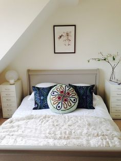 Cosy #cushions add contrast to #allwhite bedroom #embroidery #floral #pretty