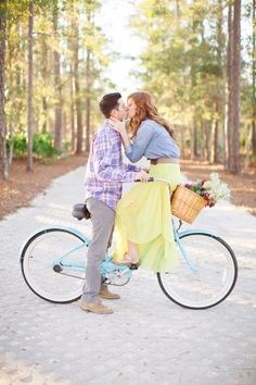 Couple Kissing on Bike