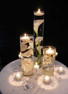 Floating candles wedding centerpiece / http://www.deerpearlflowers.com/floating-wedding-centerpieces/2/
