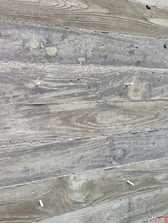 The 2×6 boards are embossed onto the concrete leaving an intricate wood grain texture on the wall's surface.