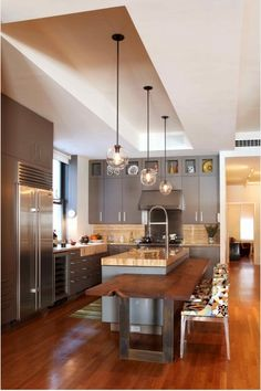 Kitchen - LOVE the built in table to sink island and the lights