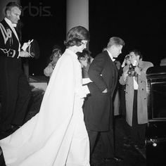 A regal President John F. Kennedy and First Lady Jacqueline Kennedy leave their new residence of the White House to attend the Inaugural Ball ~ 20th Jan., 1961