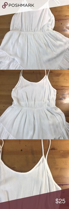 """=AUDREY 3+1=CREPE DELICATE RUFFLE ROMPER S L Feminine and delicate white crepe rayon romper shirt jumper. Spaghetti strap. Short hem has lining and ruffle wide hem. Scoop neck and back. Sexy fitted and girly. Gently used still bright white.  Large pit to pit 16"""" length 30"""" Small pit to pit 15"""" length 27"""" P Beach,resort,cruise,festival,spring break,summer,hippie,boho,date night Audrey 3+1 Pants Jumpsuits & Rompers"""