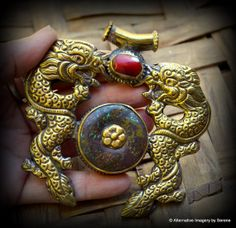 """Large Handcrafted Brass Repousse Double Dragon Red Coral and Turquoise Nepalese Focal Bead Power Totem Length: 4"""" Width: 3 1/2"""" Diameter of turquoise cab: 1 1/8"""" Depth of bead: approx. 1/4"""" to 3/8"""" Coral Cab: 1 1/8"""" long by 3/8"""" Weight: 2.26 oz Bail: 1"""" long, opening is 1/4"""" diameter  by TemplesTreasureTrove, $174.95"""