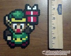link to the past perler   Link from The Legend of Zelda: A Link to the Past holding a present ...