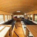 Architecture Student Converts Old Bus into Comfy Mobile Home Complete with Repurposed Gym Floor