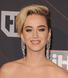 Katy Perry shocked fans around the world last week when she chopped her hair super short – and her daring makeover sparked many Miley Cyrus...