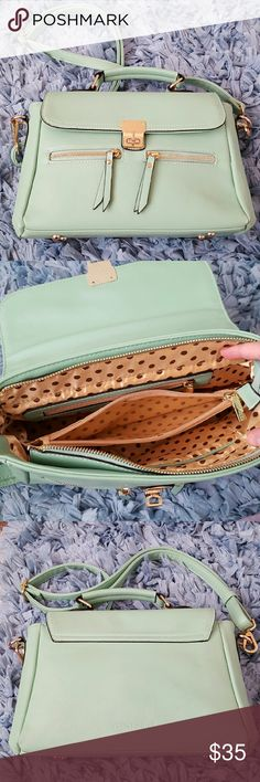 """Melie Bianco Cross Body This bag features mint green faux leather with gold trims, flap over lock closure, 2 exterior zipper pockets, sateen polka dot lining with split compartment and 4 interior pockets. Pre-loved with signs of wear and tear shown in picture #4 but is still cute and functional. Removable straps adjustable to 21"""" drop. Dimensions are 8"""" x 11.5"""" x 3.5"""". Melie Bianco Bags Crossbody Bags"""