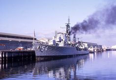 4955. This superb dockside image of HMAS DUCHESS berthed at Port Adelaide has proved very popular since transport photographer Chris Finney first posted it on the Shipspotting website several years ago, and we are very glad to be able to have it here.  The Daring Class destroyer appears to be preparing for departure, and perhaps testing power to her turrets.  A turrets guns are depressed, while B and X are at maximum elevation.  Photo: www.shipspotting.com/© Chris Finney