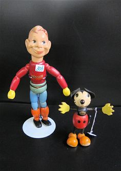 "TWO WOODEN TOYS: Mickey Mouse, a Fun-e-Flex Toy, 1930's, 6.75""H; together with Howdy Doody, composition head on wood body, by Bob Smith, 12.5""H. Estimated to sell between 1800-200. To be sold as lot 0214-0304."