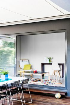 In a masterstroke, a small rear garage hugging the boundary was converted into a playroom; one wall was partially removed and the room now opens via glazed sliding doors onto a deck and the back garden.