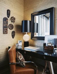Masculine Office, tan grass cloth (to pull desk in) with black high gloss built in, blk and white rug, great art work, hang TV on wall, new drapes, desk lamp, lighting