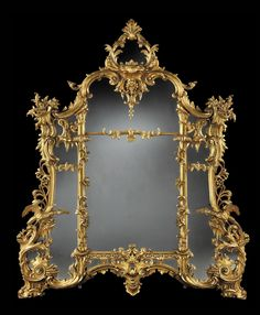 A Giltwood Mirror of Substantial Size in the Rococo Chippendale Manner. The well carved frame incorporating addorsed Ho Ho birds, 'C' scrolls, icicles, pierced trellising and foliates; of assymetrical form and housing a mercury backed mirror plate. Fancy Mirrors, Old Mirrors, Ornate Mirror, Vintage Mirrors, Mantle Mirror, Mirror Mirror, Mirror Image, Style Ancien, Mirror Plates