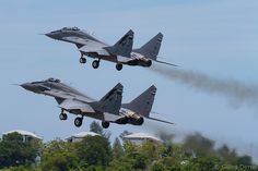 "Royal Malaysian Air Force Mikoyan MiG-29N ""Fulcrum"" (left) and MiG-29NUB ""Fulcrum-B"" (right)"