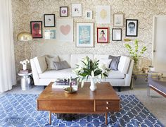 Eggshell Home Blog - Living room with rug over carpet. Gallery wall. Blue patterned rug. Design by Emily Henderson for Oh Joy!