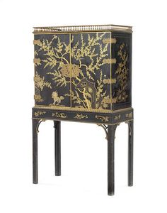 A George Iii Black And Gilt Anned Cabinet On Stand