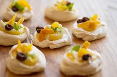 Mini pavlovas with dried fruit & lemon curd  Bites of meringue heaven! Tangy curd and delicious dried fruit bits on little meringue clouds, what could be better?