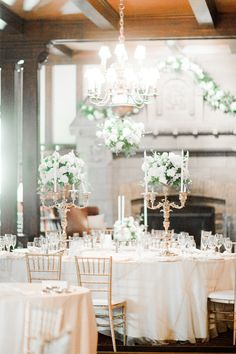white, gold, and green elegant ballroom reception