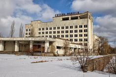 The Polissa hotel in the central square of Pripyat. Some of the stenciled figures made by a German/Belarusian group illegally in 2005 can be seen on the closest building