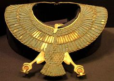 Golden collar in the form of a vulture which is grasping two ankh. It is made with lapis-lazuli, rock crystal and gold. Cairo Museum, Egypt.