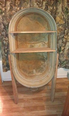 Taking a old oval wash tub and turning into a new antique bathroom towel holder.