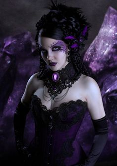 Purple AND gothic...I couldn't pull this look off altogether (like this gal does so well), but I love the choker, the corset and the hairpiece!