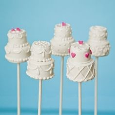Adorable and extremely cute traditional Wedding Cake cake pops! Anna can you make these for me?!