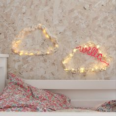 Recreate the texture of a gently cloudy sky with a matching pair or contrasting duo of cloud wall decorations. The clouds are available as woven, plaited or with pompoms and sprinkled with twinkly fairy lights. The merino wool is so soft to touch and with the pompom cloud there's an option to personalise it with up to 8 letters. #cloudwall #decorideasforkids #kidsdecor #kidsdecoratingideas Fairy Lights On Wall, Rustic Wedding, Our Wedding, Modern Kids Bedroom, Light Words, Cosy Bedroom, Battery Lights, Floral Garland, Kids Decor