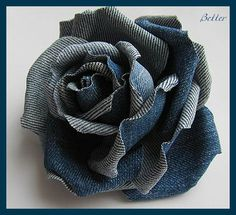 Recycle the Denim into flowers and create wall hangings, adorn baskets, add a wire or wood stem and put in a vase, etc.