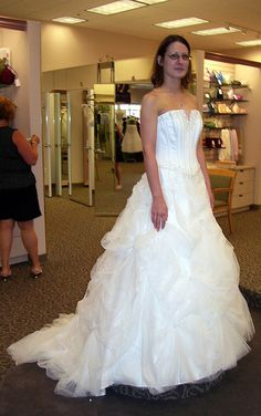 I really need some opinions. Please tell me what you think of the following dresses. There are five dresses I REALLY liked. This is the order in which I tried them on.   Sorry its a bit blurry.  David's Bridal    *Note: All of the gowns I tried on were t gown