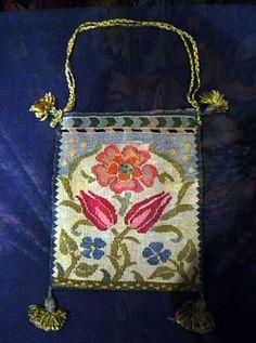 Çok hoş..Bizim geleneksel işlerimize çok yakın, hem heybe, hem nakış olarak --a bag embroidered by May Morris.