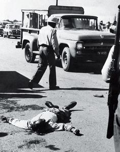 A body lies sprawled in street in Sharpeville, South Africa, on March Sixty-nine black protesters were killed by police in Sharpeville. A state of emergency was declared, and the ANC was outlawed. Photo credit: AP — in Sharpeville, Gauteng.