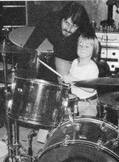 John Bonham teaching his son Jason the drums