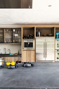 Pitt Cooking, stoer hout en robuust beton De combinatie van …
