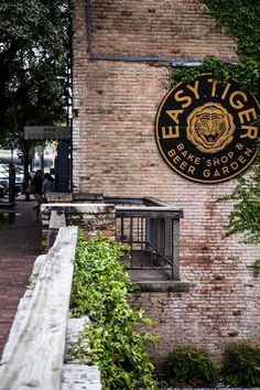Easy Tiger: beer garden and bakery. Homemade sausage and pretzels, sandwiches, breads. Lots of beers on tap. Open early and late. In a really overlooked part of downtown Austin where Shoal Creek runs through downtown and it is really great.