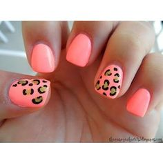 Coral nail polish with accented leopard print nails, perfect for #summer!