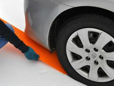 Portable Tow Truck.  This ingenious device is a traction mat that is designed to get your car out of a tight spot and save you from costly tow truck charges. Simply wedge it under the pulling wheel and drive away safely.