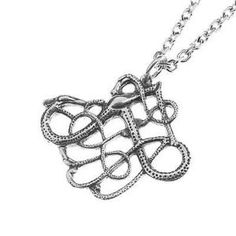 """11TH CENTURY STYLE NECKLACE - A necklace in the socalled """"Urnes"""" - style, from the middle of the 11th century. The necklace shows a big animal with its head to the right, curved neck and distinctive forefeet, and the belly ends in two tails. Two snakes wind around the neck and feet. The """"Urnes"""" - style is the latest of ornamnetnal styles of the Viking era. The original in silver. Big Animals, 11th Century, Snakes, Fashion Necklace, Vikings, Handmade Jewelry, Middle, Silver, Style"""