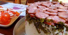 1kg de carne (paleta ou carne de charque) cortada em cubos(2,5x2,5)   - 100g de lingüiça defumada em cubos   - 5 folhas de couve cortada em tiras finas (normal)   - 3 copos americanos de arroz pairboilizado   - 3 dentes de alho amassados   - 1 e 1/2 colheres (sopa) de tempero   - 1/2 copo americano de óleo de girassol   - 1 cebola grande picada  -