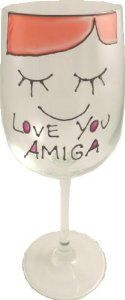 Love you Amiga Wine Glass by Folk Rock. $34.95. Hand Painted in the UK. In relief with infills of colour.. Design and Wording as shown.Signed by the Artist. A contemporary design on a tradtional sentiment. Gift Boxed. Contemporary design on fully washable wine glasses standing 22cm high and holding 35cl of your favourite tipple.Hand Painted in the UK.Design and Wording as shown, comes gift boxed with a card of authenticity.
